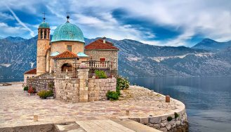 Stone building on an island on the lake in scenic Montenegro